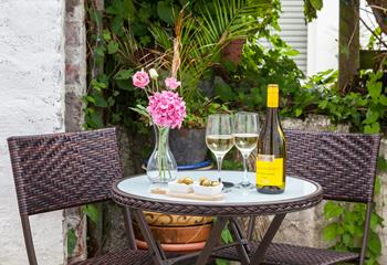 Soak up the evening sunshine at the bistro table and chairs in the courtyard.