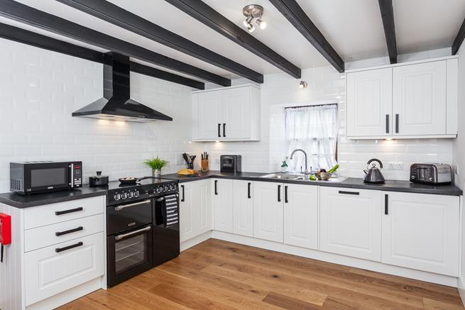 Large, well equipped kitchen.