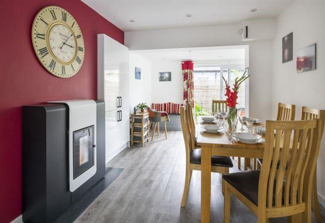 Biomass central heating system in the dining area.