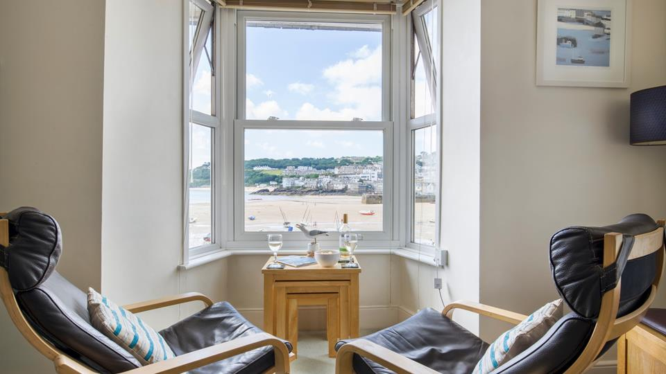 Relax in the leather recliner chairs with a glass of wine, looking out from the bay window across St Ives Harbour and beach..