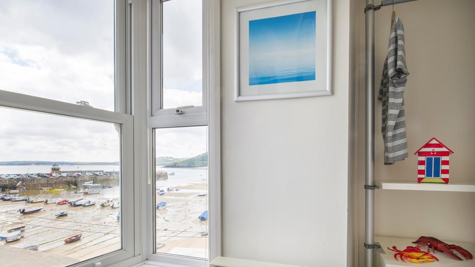 Bedroom one has a fabulous view across the harbour and beach, there will always be something to view from the bay window.