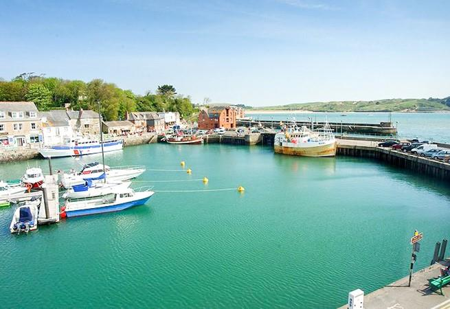 Enjoy unrivalled views of Padstow's quaint working harbour from the apartment.
