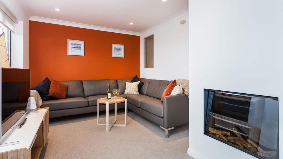 Cosy up with a glass of wine in the living room and watch a film, or simply gaze out to sea.
