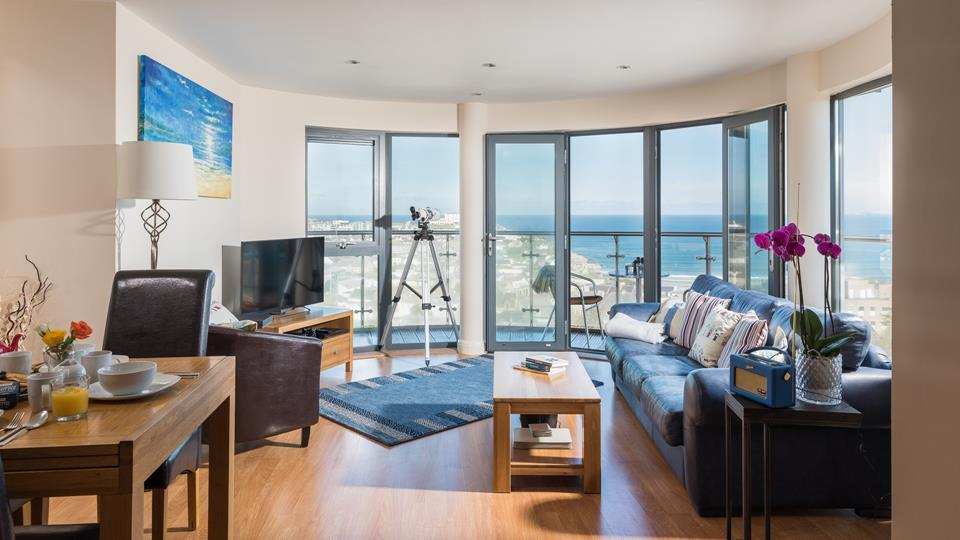 The open plan living area has fantastic floor to ceiling windows, making the most of the properties sensational sea views.