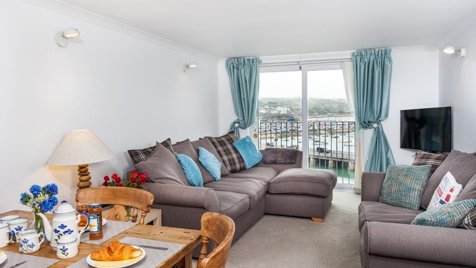 Open plan sitting/dining room with fabulous views across Penzance Harbour and out to sea.