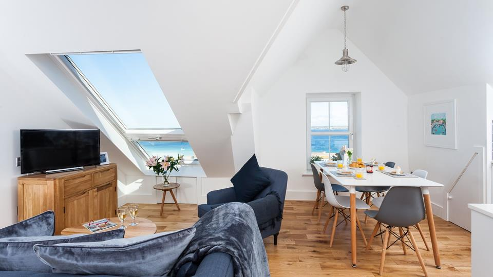 Little Gem has fantastic sea views from the open plan living space, natural light pours in from the Velux window.