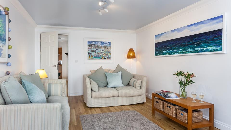 Sink into one of the comfy sofas and watch some TV, or simply enjoy the wonderful sea views.