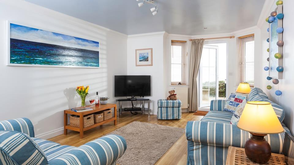 The coastal interiors are very fitting in this sea view apartment.