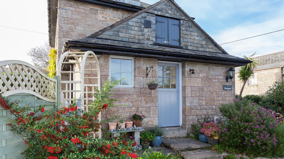 We love the adorable stable door to the rear of Folnamodry.