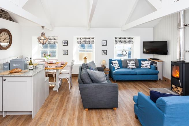 Enjoy quality time together in the nautical themed open plan kitchen, dining and living room, around the stylish woodburner.