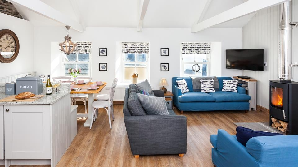 Enjoy quality time together in the nautical themed open plan kitchen, dining and lounge.