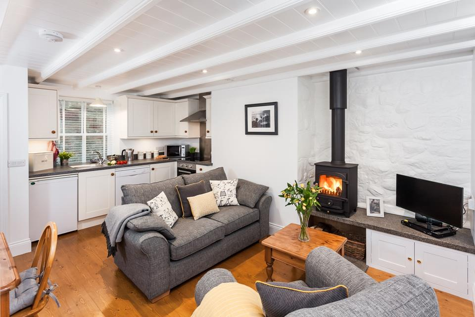 The cosy open plan living area in this charming cottage offers the perfect setting to escape from it all.