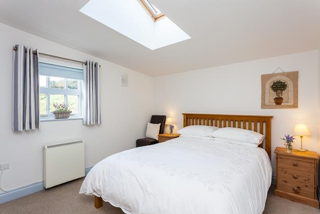 The peaceful surroundings will help you get a good night's sleep in the comfy king size bed.