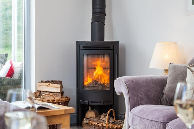 Warm your toes by the cosy woodburner.