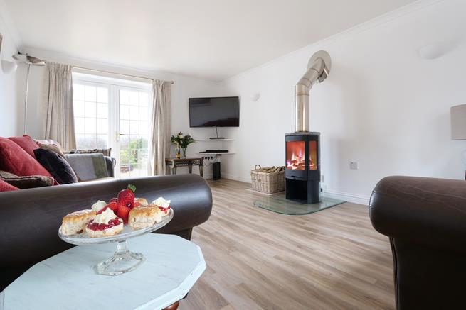 Spacious and airy sitting room with a woodburner to snuggle up next to in the evening.