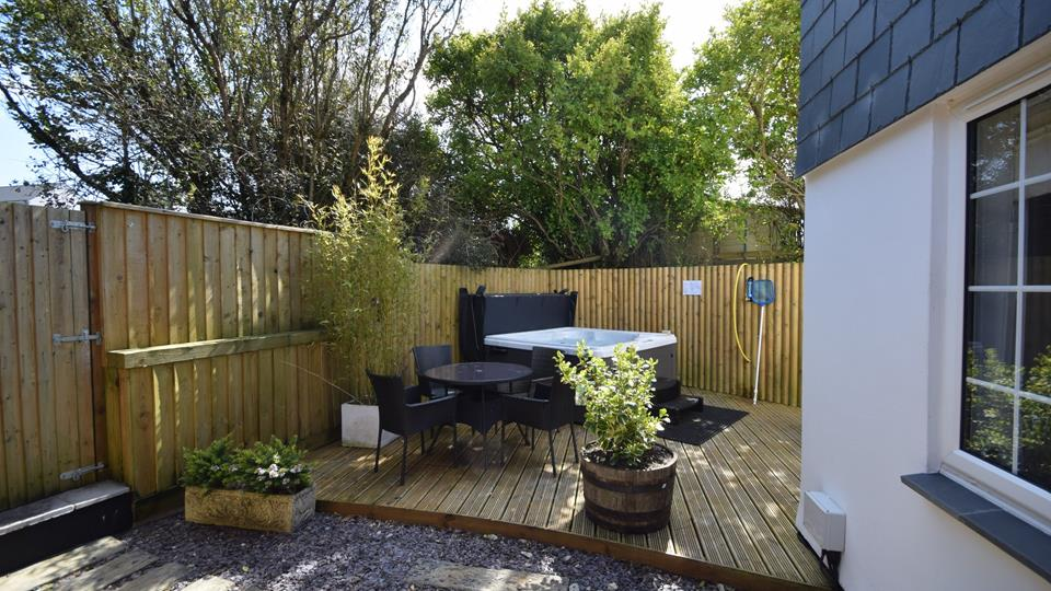 Relax with a glass of bubbly in this lovely hot tub which is set in the corner to the rear of the property on a raised decking area. Rattan table and chairs are available for some alfresco dining.