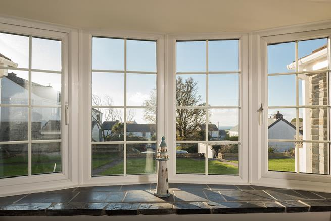 From the lovely large window you can spot the sea which is only a mile away.