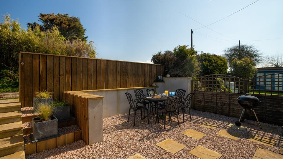 The enclosed garden is great for dining, or enjoying a drink outside in the sunshine.