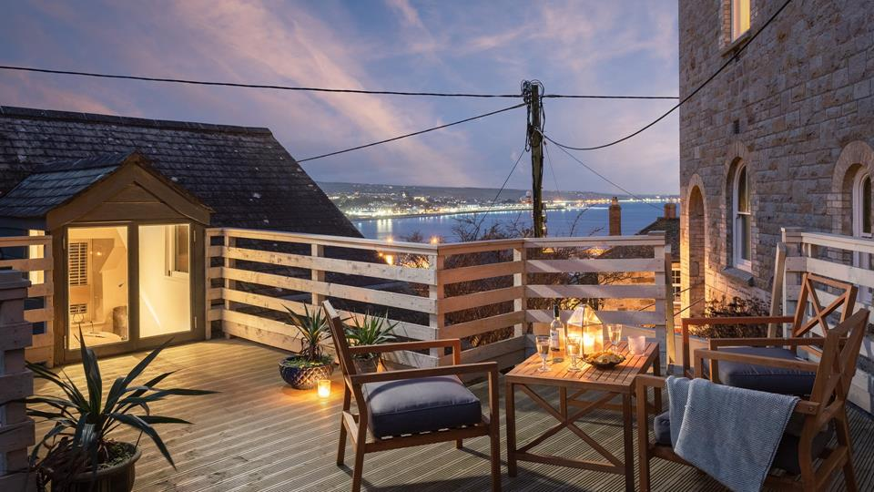 This picturesque setting overlooking Mousehole is the perfect place to enjoy a glass of wine.