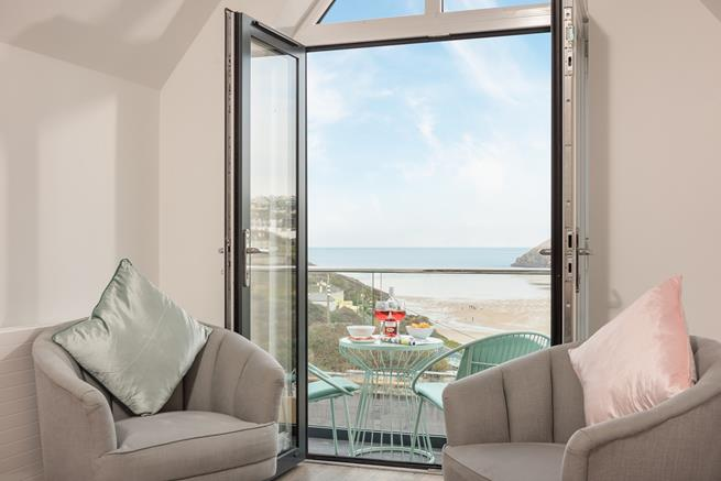 Open up the balcony doors to enjoy the coastal breeze or enjoy a drink on the balcony with amazing sea views.