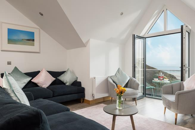 Enjoy your morning coffee with breathtaking views of Mawgan Porth beach and the Atlantic ocean.