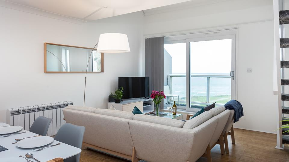 The corner sofa is positioned so that you can make the most of the fantastic view over Porthmeor beach.