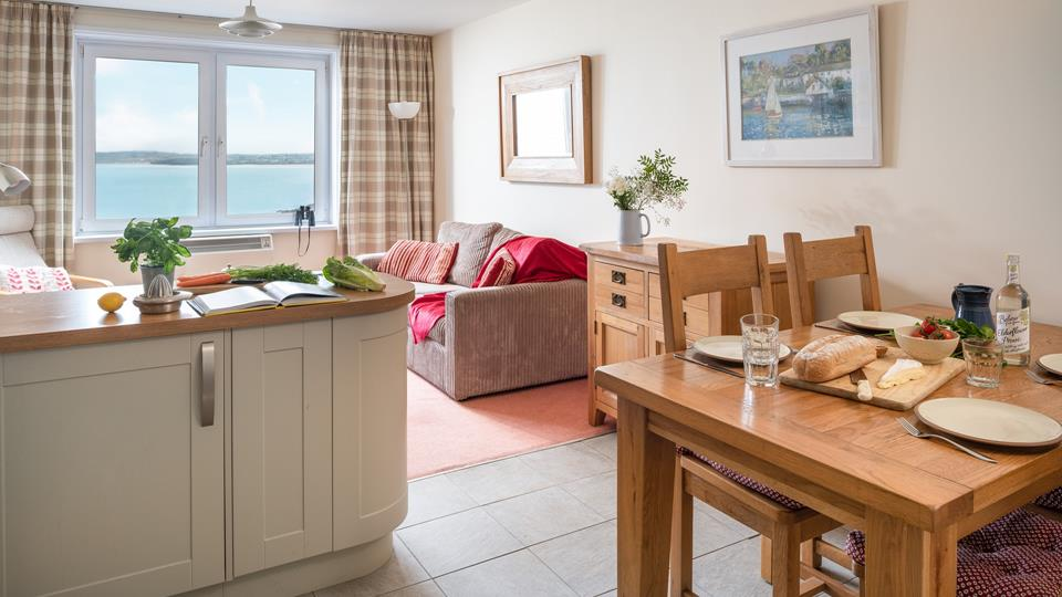 The open plan kitchen, dining and sitting room works well and you can see the sea from every angle.