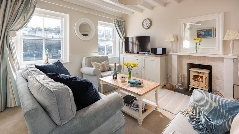 Make memories in the cosy, cottage-style, living area; light the woodburner and share stories of your holiday adventures.