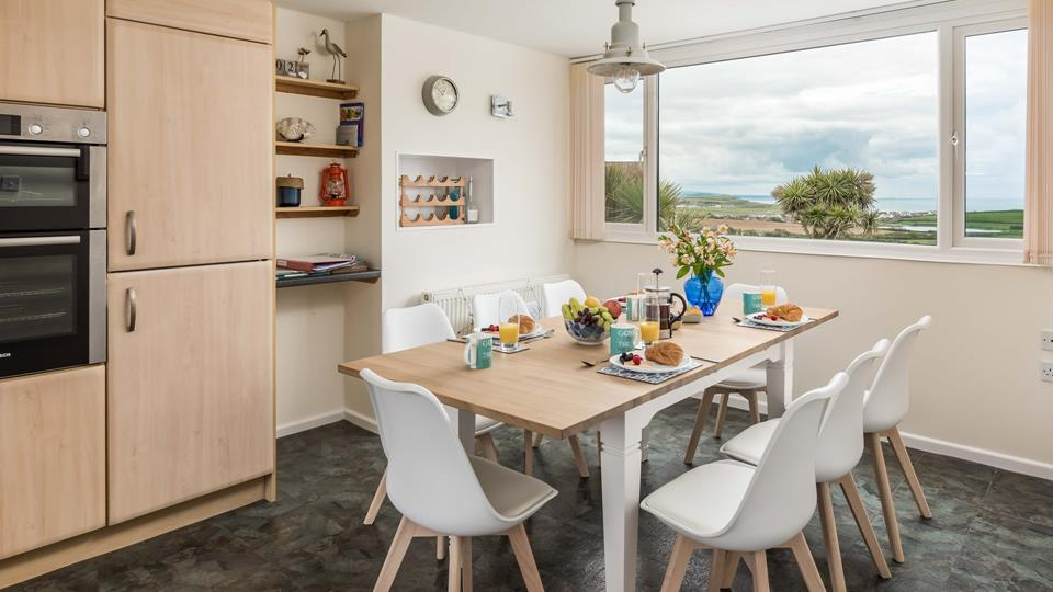 The dining area is perfect to enjoy the rolling countryside and fabulous ocean view.