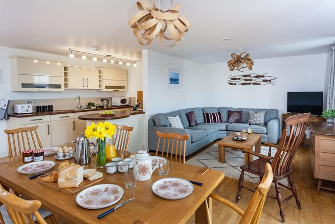 Easy open-plan living with sea views at Ocean Blue in Praa Sands,  with all rooms on on level.