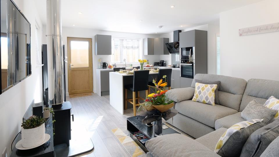 Extremely well designed open plan kitchen, dining area with a super size sofa to relax next to the woodburner in the evening.