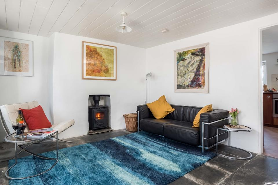 Relax and enjoy the atmosphere in the sitting room beside the lovely wood burner.