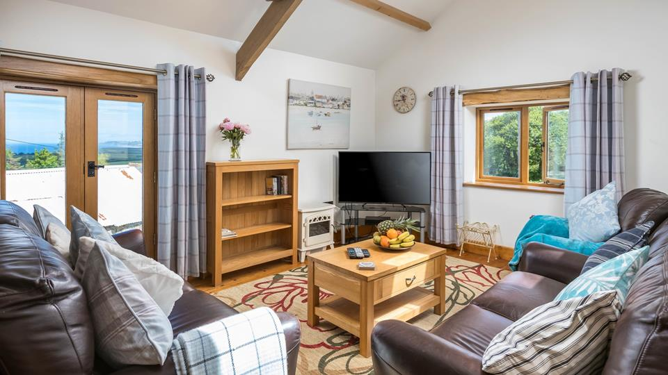 Relax in the sitting area which has a stunning view across Widemouth Bay and Lundy Island.