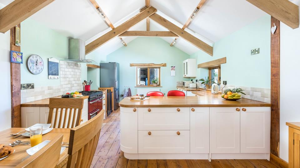 Fabulous open plan kitchen with sitting and dining area, beams and oak flooring give a tremendous country living feel.