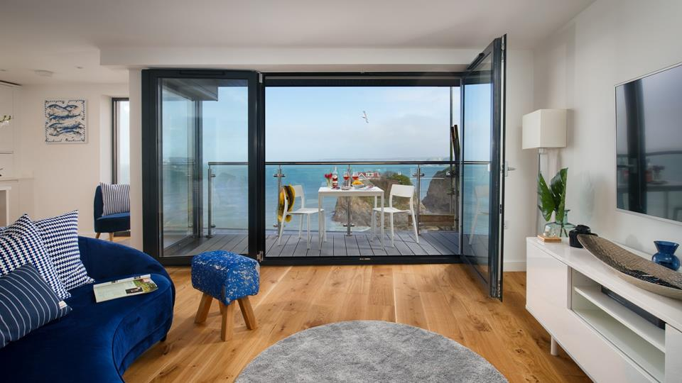 Let the sounds of the sea fill the open plan living space. Inward opening doors make the most of the balcony space.