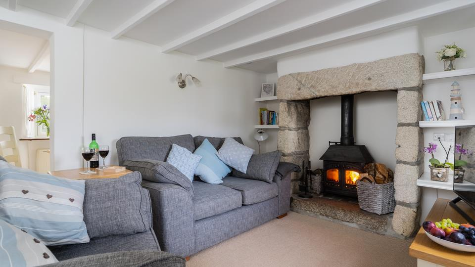 The cosy cottage living area with woodburner.