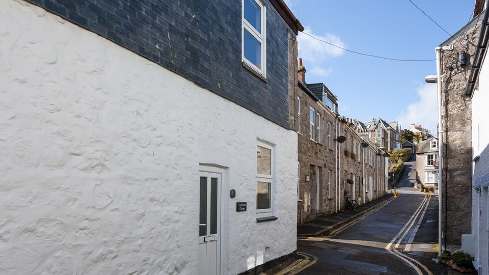 Narrow streets with historic architecture create a tremendous atmosphere in St Ives.