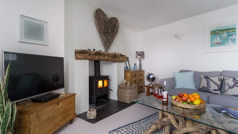 Relax on comfy sofas next to the log burner