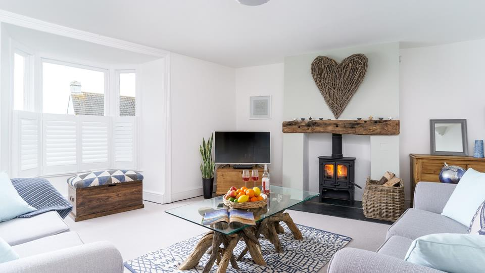 Stylish living room with log burner and comfortable sofas