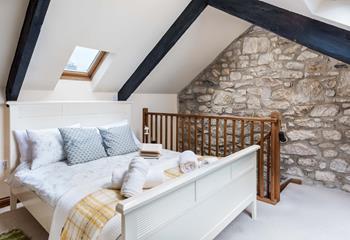Double bedroom on mezzanine level.
