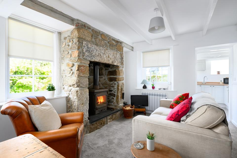 Snuggle on the sofa and warm your toes in front of the woodburner.