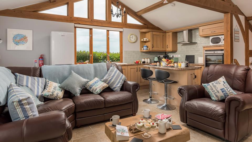 The light and airy open plan living space features traditional, handcrafted oak beams for a country living feel.