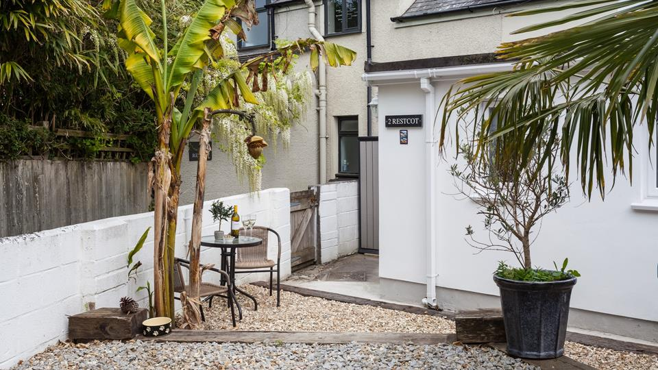 The rear outside area has been terraced using reclaimed sleepers and gravels, a metal and caned chairs bistro set is perfect for an evening drink.
