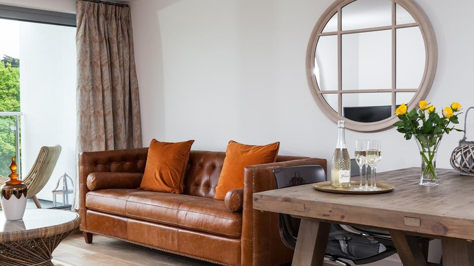 Relax in the leather Chesterfield sofa with a glass of your favourite tipple, while the sea breeze floats in through the open patio doors.
