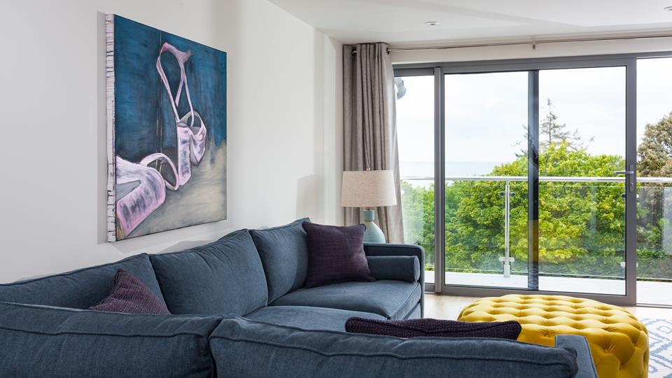 Beautifully finished, the apartment features contemporary artwork and modern furnishings.