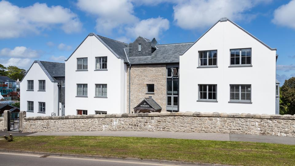 Traditional stone, slate roofing and great architectural design have achieved a building with great presence.