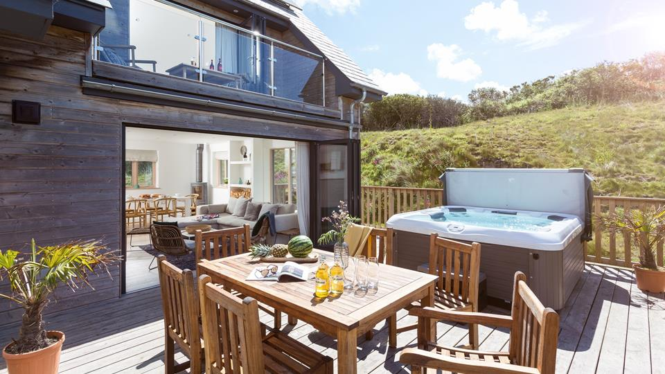 Open up the bi-fold door from the open plan living area and bedroom three to the salty Cornish breeze, enjoy food and drinks on the deck area and relax in the hot tub.