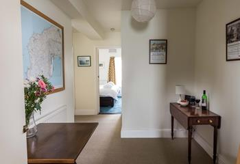 The entrance hall gives access to the bedroom and living areas.