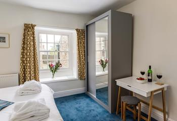 Bedroom with modern en suite shower.