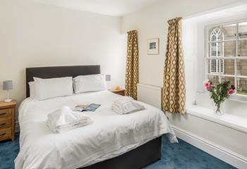 Comfy king size bed overlooks Chapel Street and St Mary's Church.